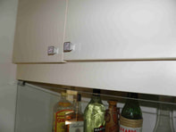 Cupboard door hinge adjustment